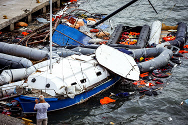 Life Jackets, Inflatables and sunken boats in the port of Kos - Greece ./Lars Berg / VISUM