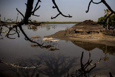 Africa, Guinea-Bissau, Djobel. 2013-03-26. The rising tide in the lagoon separates houses and.../Ernst Schade