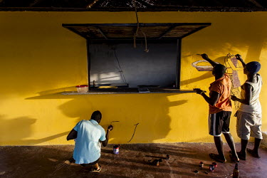 Africa, Guinea-Bissau, Cacheu. 2013-03-21. Men create a wall painting in the local bar and.../Ernst Schade