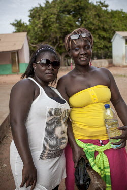 Africa, Guinea-Bissau, Cacheu. 2013-03-23. Two women in festive dress are on their way to a wedding.../Ernst Schade