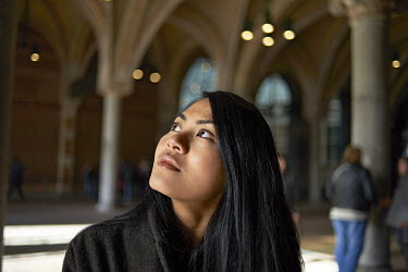 Portraits of an Asian female tourist enjoying the sights around Rijksmuseum in Amsterdam/Sash Alexander
