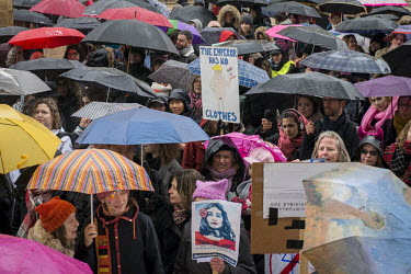Protesters listen to a speech sheltered under the umbrellas because of the rain at the women's.../Rose Lecat / Hans Lucas