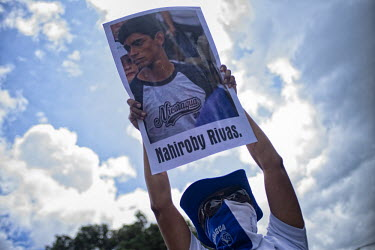 Central America - Nicaragua, capital city Managua: An anti-Ortega rebel holds a poster with the.../Juan Carlos