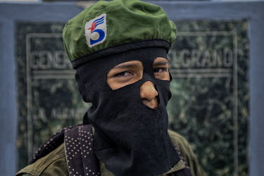 Central America - Nicaragua, capital city Managua: An anti-Ortega rebel using the pseudonym.../Juan Carlos