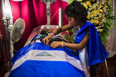 Central America - Nicaragua, capital city Managua: Paola arranges the spent bullet shells on top of.../Juan Carlos