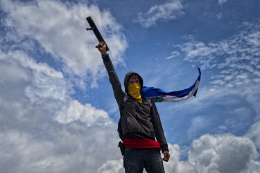 Central America - Nicaragua, capital city Managua: An ant-Ortega rebel holds his makeshift.../Juan Carlos