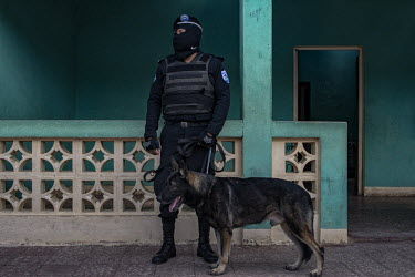 Special forces police police member and an attack dog in the occupied town of Monimbo after it was.../Juan Carlos
