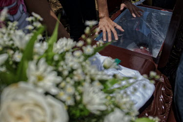 Central America - Nicaragua, Monimbo: Family and friends weep over the death of Eric Jimenez during.../Juan Carlos