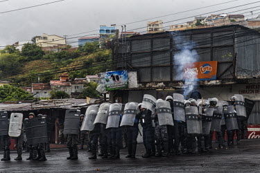 Central America - Honduras, capital city Tegucigalpa: Soldiers firing tear gas to protesters and.../Juan Carlos