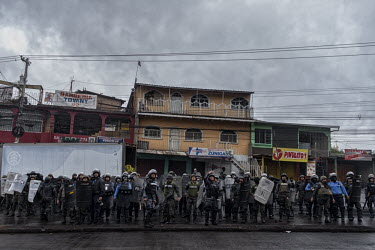 Central America - Honduras, capital city Tegucigalpa: Soldiers on guard and ready to fire tear gas.../Juan Carlos
