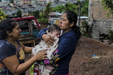 Central America - Honduras, capital city Tegucigalpa: A baby shocking due to inhaling tear gas, the.../Juan Carlos
