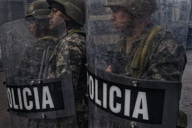 Central America - Honduras, capital city Tegucigalpa: Soldiers stand guard to repress supporters of.../Juan Carlos