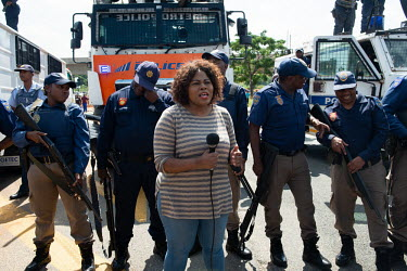 JOHANNESBURG 03042019 A news reporter is talking in front of a police line-up during a protest.../Frank Trimbos