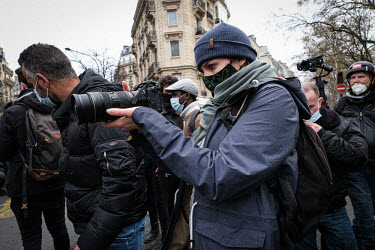 People shoot images during demonstration in Paris/Fred Marie / Hans Lucas